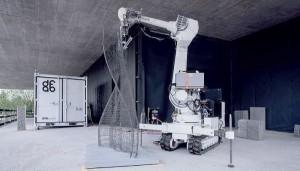 Robô fabrica a malha de aço que recebe o concreto e dispensa fôrmas