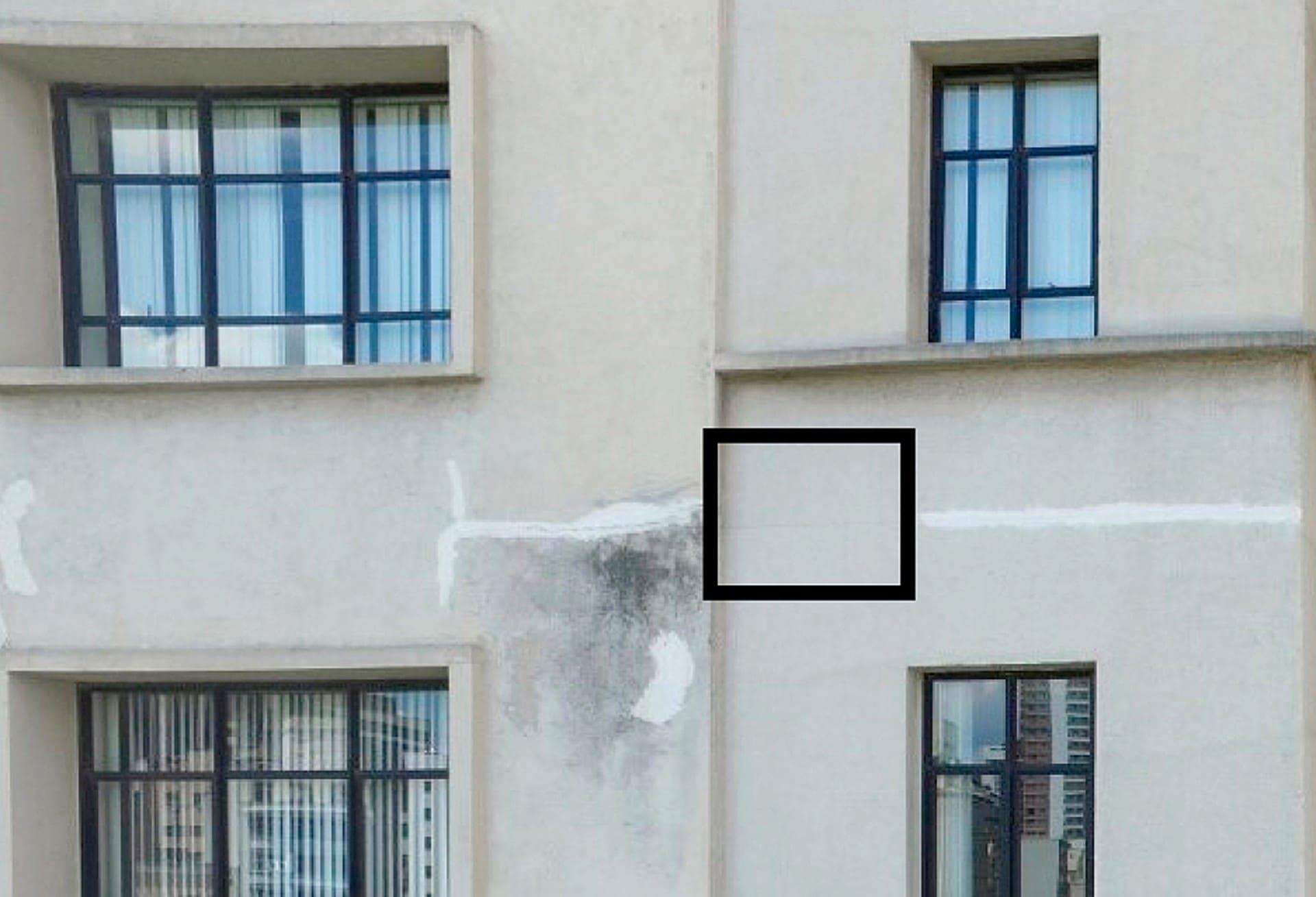 Imagem sem uso de câmera termográfica mostra fachada de edifício com área danificada e área aparentemente saudável (quadrado menor) Crédito: IPT